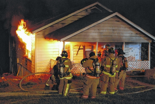 Firefighters burn house for training