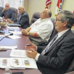 County board OKs 'painful' payment