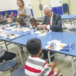 Athletes, officials serve lunch