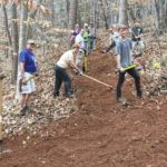 Elkin Methodist and Presbyterian churches join EVTA to improve trails on Earth Day